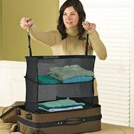 Arrange your clothes on Hanging Shelves that drop into your suitcase. When you arrive at your hotel there's no need to unpack, simple hang them in your closet!