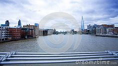 A view of the Thames and the river bank from the Millennium Bridge in the city of London.