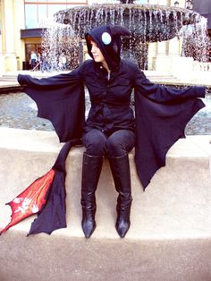 Something like this... Toothless cosplay