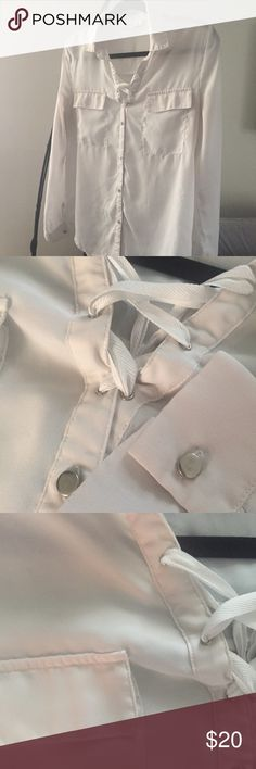 TWO SISTERS Sheer White Lace Up Blouse Worn once! Beautiful and delicate, this blouse can be paired with high waisted jeans for a polished weekender look, or a pencil shirt for the office! Features silver toned buttons and laced plunging neckline.  ✅ Trades ✅ Offers!   Smoke and pet free home. ii sisters Tops Button Down Shirts