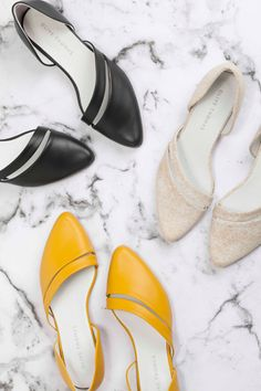 Blending an asymmetric silhouette with an eye-popping hue, these slip-ons are…