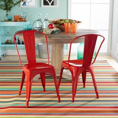 Dining room with pale blue walls and red chairs. Love the stripe rug!   I love this decor!!!