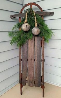 sled decorated with a garland and ornaments #porchIdeas #porch #winter #frontDoorDecor #homeDecor #patiodecor
