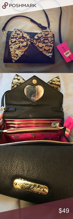 """Betsey Johnson Purse Wallet NWT!. Has a random white ish """"X"""" mark on the inside but it seems washable. Leopard color sequin bow on the outside. Magnetic closure. Lots of space for cards and such. Strap can be taken off for the bag to be used as a clutch. Has a mirror inside with the plastic still on! Betsey Johnson Bags Clutches & Wristlets"""