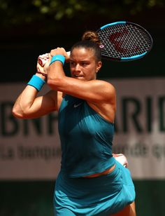 Maria Sakkari of Greece plays a backhand during the ladies singles first round match against Mandy Minnela of Luxembourg during day two of the 2018 French Open at Roland Garros on May 2018 in Paris, France. Tennis Center, Billie Jean King, French Open, First Round, Tennis Players, Luxembourg, Tennis Racket, Paris France, Plays