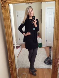 Love the black dress with grey tights.