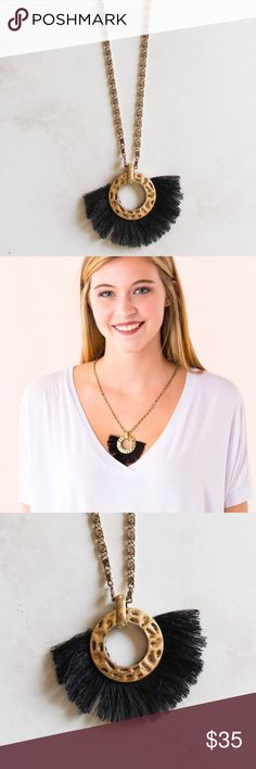 "Black Feathered Tassel necklace on gold circle Black Feathered Tassel Gold Circle Necklace  GOLD/BLACK This gold necklace features a feathered, tasseled black detail around a gold circle. This necklace also features an adjustable, metal clasp.  Length: 11"" Jewelry Necklaces"