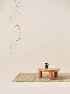 Modelled on acrobats' hoops, these brass lights link together. Each hoop is surrounded by LED lighting.
