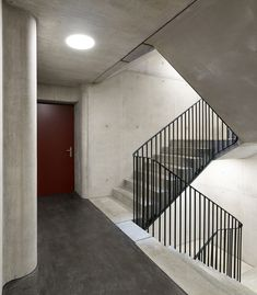 Image 8 of 16 from gallery of Eyhof Housing / Adrian Streich Architekten AG. Photograph by Roland Bernath Auditorium Design, Grill Door Design, Stair Handrail, Narrow House, Industrial Architecture, Interior Stairs, Dormitory, Staircase Design, Stairways