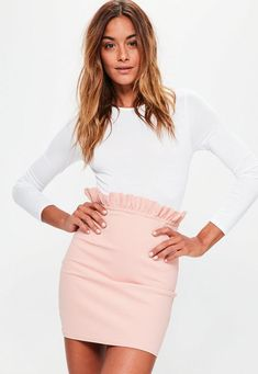 raise your hemlines wearing this mini skirt in pink - featuring frill details at the waist, a figure hugging style and mini length.