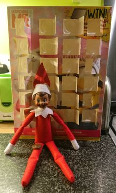 Elf on the Shelf eats the advent calender