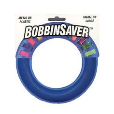 Bobbin Saver Bobbin Storage Ring in Blue -- neat idea -  re-purposing medium sized spice containers - clear, white lids, (not ones that actually contained spices)