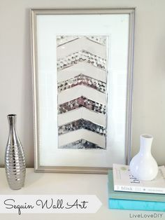 LiveLoveDIY: Wall Art: Make Chic Art For CHEAP!- she took a framed picture from goodwill, spray painted the frame AND mat, then made a sequined picture to frame---sooo cute!