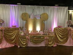 Beautiful Pink and Gold Minnie dessert table. Fatima's 1st Birthday