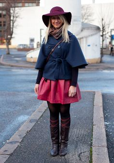 "Suvi, 23  ""I'm wearing a Sfera hat and skirt from Spain, a Vila jacket and second hand boots.  I like hats, hoods, reddish and down-to-earth colours and interesting details like the sleeves on my jacket."""