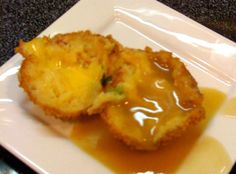 Great Balls Of Fire | Deep fried mashed potato balls infused with bacon, garlic, and Sriracha with cheddar cheese centers and covered with gravy.