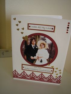Ruby anniversary commission featuring a wedding photo.  Spellbinders border, sprinkled with gold hearts.