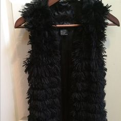 Daytrip Black faux fur vest Black soft faux fir vest, hits below waist, great layering piece, perfect condition size small Daytrip Jackets & Coats Vests