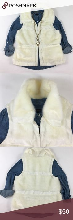 Rachel Zoe Faux Fur Vest! Chic faux fur vest is both comfy and stylish with razor cut lines to cinch your waist and minimize the extra weight of a fur vest. Fully lined with satin and hook and eye closures and working front pockets. 22 inch bust laid flat. Fits more like an XL. Rachel Zoe Jackets & Coats Vests
