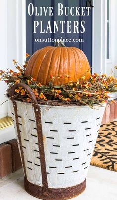 DIY Fall Olive Bucket Pumpkin Planters | Easy way to raise the pumpkins without filling up the olive buckets. Super easy and quick.