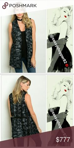 Just arrived!! Black and silver metallic fur vest New without tags  S-m-l Limited quantities    Add a new twist to your fur vest collection with this glamorous faux fur vest featuring a dazing silver metallic sheen on soft black faux fur!!! Pair with leggings, comfy sweater and boots or a mini sweater dress and thigh high boots!!   Belt included 60%polyester/40%PUC, light weight vest Faux fur in black and glamorous silver metallic. Boutique Jackets & Coats Vests
