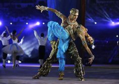 Performers dance during the closing ceremony of the 2014 Winter Olympics, Sunday, Feb. 23, 2014, in Sochi, Russia.