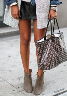 Love the details...from her suede ankle booties to her herringbone vest.