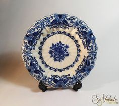 Dutch Frisian Makkum Tichelaar pottery wall plate, entirely hand-painted in monchrome cobalt blue tones with an ornate pattern of flowers and curls etc. Ceramic charger from Friesland in the Netherlands with a wonderful scalloped edge. This gorgeous find is on offer by SoVintastic on Etsy.