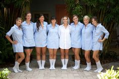 put bridesmaids in oversized, button-downed shirts monogrammed for each bridesmaid (white for the bride). cute and easy for getting ready before the wedding.