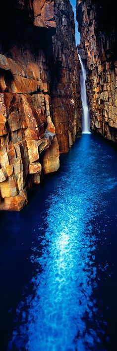 Beautiful waterfall into a sapphire pool - Kimberley coast gorge, Western Australia Places Around The World, Oh The Places You'll Go, Places To Travel, Around The Worlds, Vacation Places, Beautiful Waterfalls, Beautiful Landscapes, Beautiful World, Beautiful Places