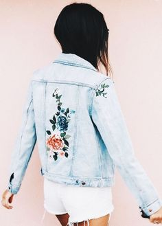 0d52a4f7aa Cute denim jacket with embroidered floral accents.