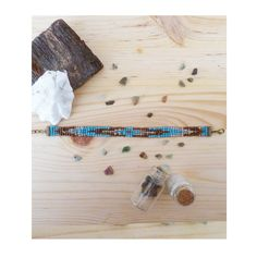 https://www.alittlemarket.com/bracelet/fr_manchette_de_perle_lucie_bleu_cendre_bronzes_transparentes_tissee_a_la_main_-17627345.html