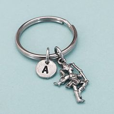 Baton twirler keychain, baton twirler charm, majorette keychain, majorette charm, personalized keychain, initial, customized, monogram. Baton twirler charm keychain with hand stamped initial *Initial charm is antique silver pewter 9mm *Baton twirler charm is antique silver pewter *Your purchase will arrive packaged in a cute gift box and I will include a message by request.