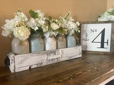 This set includes everything you see in the picture. Decorate your family kitchen table or complete your rustic wedding with this custom piece This individual items includes: chalk painted jars: S Farmhouse Kitchen Tables, Farmhouse Decor, Rustic Mason Jars, Mason Jar Centerpieces, Painted Jars, Mason Jar Crafts, Diy Table, Dining Table, Etsy