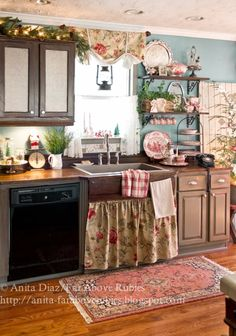 Farmhouse Kitchen...cute, cute, cute! Love the little curtain over the bottom cabinets and the wire for hanging towels! - country and shabby chic home