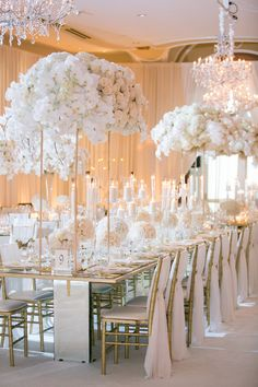 opulent wedding reception with ivory and gold, floral arrangements on tall gold stands, chandeliers All White Wedding, Gold Wedding, Elegant Wedding, Wedding Table, Floral Wedding, Wedding Colors, Wedding Flowers, Dream Wedding, Ivory Wedding Decor