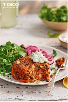 Spice up your veggie burger recipe with these cumin carrot, lentil and feta patties. Served bun-less, with marinated onions and creamy tzatziki, it's a brilliant way to enjoy a healthy burger. | Tesco