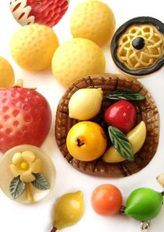 Beautiful bright Marion Weeber vintage fruit basket button and other celluloids.