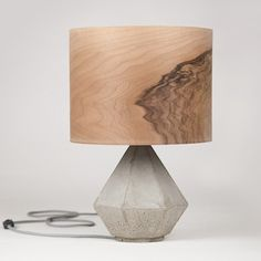 Like the concept of a cement base with industrial cord, but my favorite part is the wood veneer shade