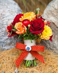 I love the textured ribbon wrapped around these flowers  #Bouquet