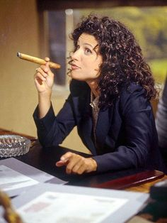 """Julia Louis-Dreyfus as Elaine Benes in Episode 1 """"The Foundation"""" from the television show Seinfeld. Cigars And Women, Women Smoking Cigars, Smoking Ladies, Cigar Smoking, Girl Smoking, People Smoking, Good Cigars, Cigars And Whiskey, Elaine Benes"""