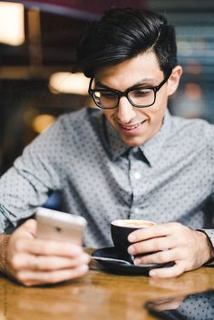 Businessman using a mobile phone during a coffee break