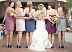 Having complimenting different shades for the bridesmaids' dresses might be nice for such a large bridal party...add visual interest to the photos