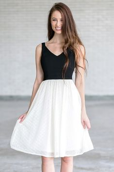 If you're looking for an elegant and classy dress for your next party, this is the one! The Bow With Me Black and Ivory A-Line Midi Dress has a subtle V neckline, empire waist, and an A-line midi cut. The top is made of a textured black fabric, and the skirt is made of ivory mesh. An invisible layer of tulle underneath the skirt adds volume to the skirt. A fabric bow in the back of this dress adds a girly and unexpected touch. A hidden side zipper completes this dress. The Bow With Me Black…