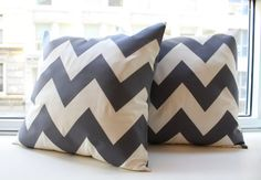 Charcoal Gray Chevron Pillow. I hate to still be on the chevron craze, but its still pretty awesome.