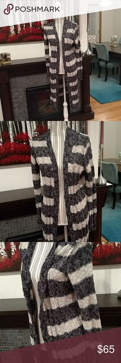 Free People Sweater Dark blue and oatmeal color. Very long. No buttons. Cozy and comfy. Softer than it looks. Great with a pair of jeans, a tank and boots.  Make me an offer 🌷. Thanks for looking!! Free People Sweaters Cardigans