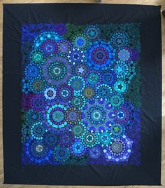 Diane K got her millefiori quilt top pieced. Now it's time to quilt!
