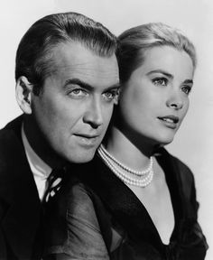 James Stewart and Grace Kelly, promotional shot for REAR WINDOW (1954).