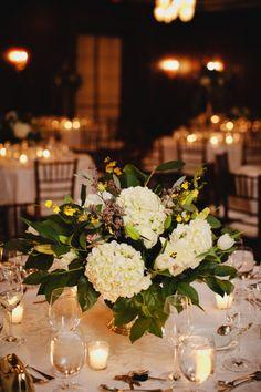 Cream Hydrangea and Magnolia Leaf Reception Arrangement | photography by http://www.kristynhogan.com/