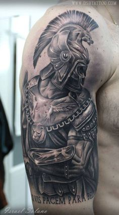 "Black and grey style roman fighter tattoo, together with the latin quote ""Si vis pacem, para bellum"", located on the right upper arm and shoulder."